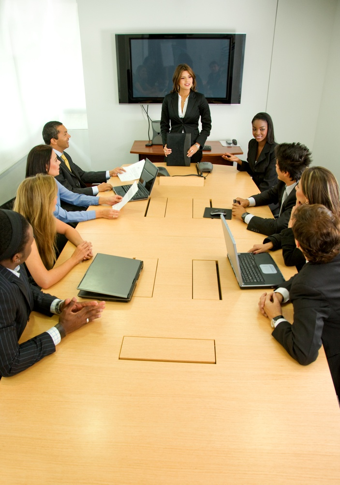 businesspeople in a business meeting in an office smiling.jpeg